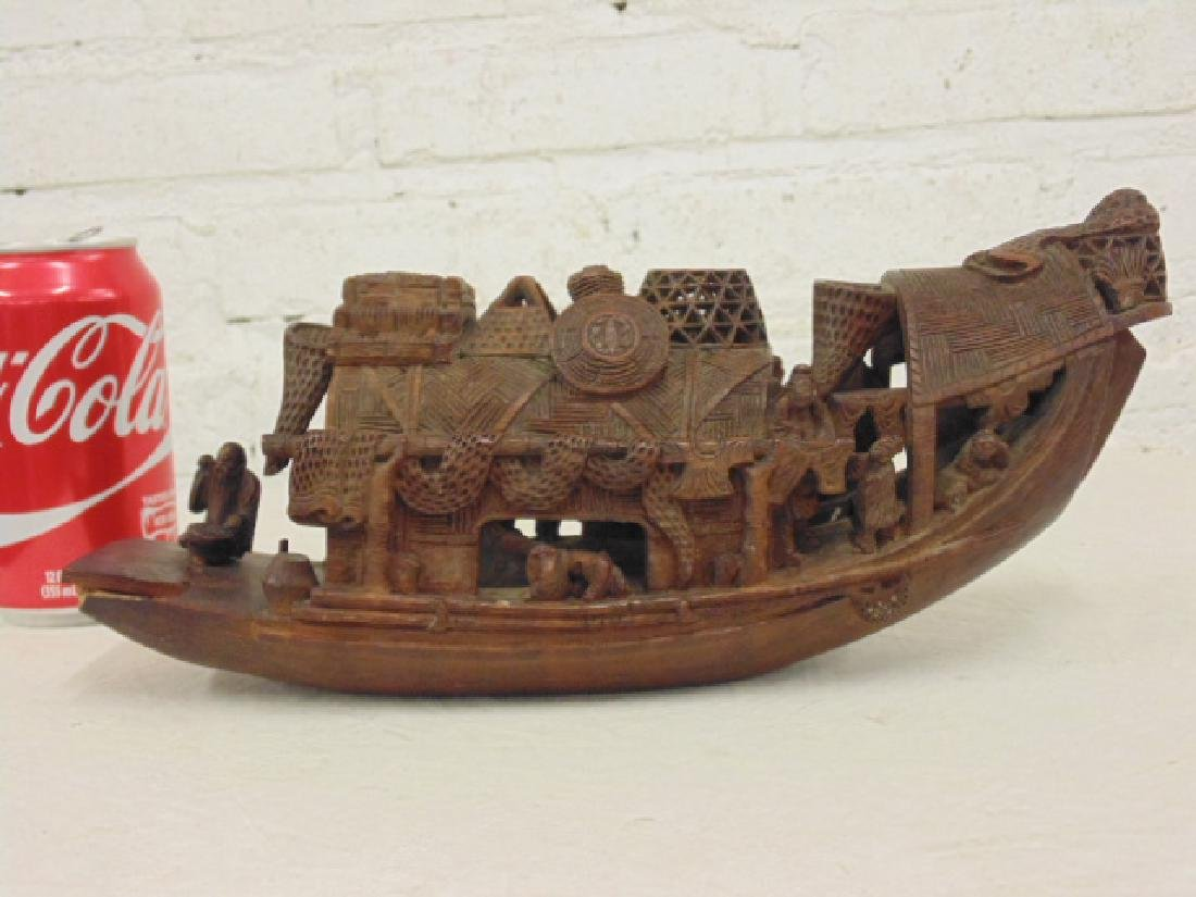 Asian carved boat, junk, carved figures