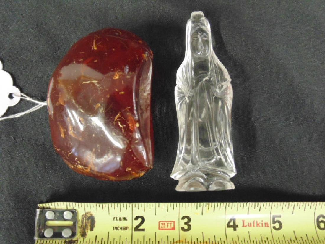 Piece of amber & small crystal Buddha figure