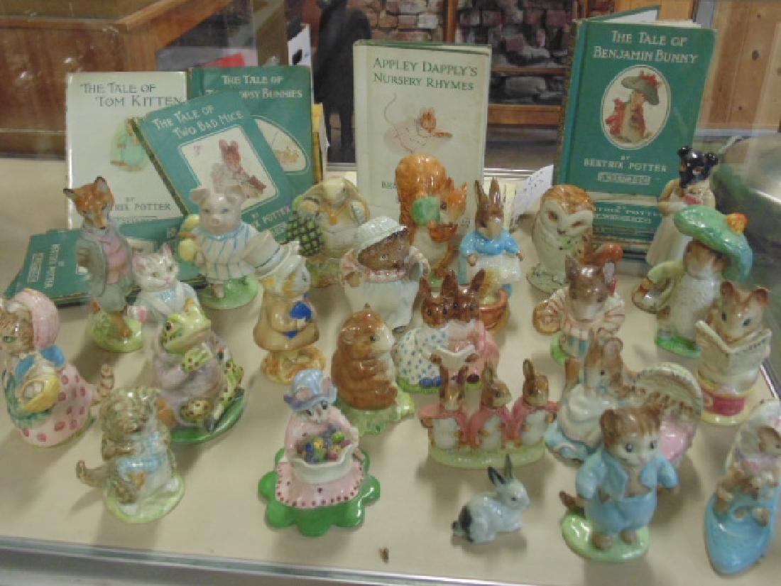 24 porcelain Beatrix Potter figures & 14 books