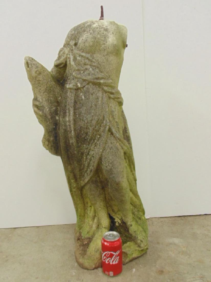 Carved marble statue, woman with fish