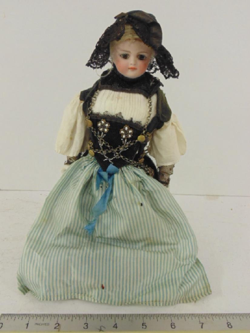 Bisque doll, porcelain head & arms, in ethnic dress