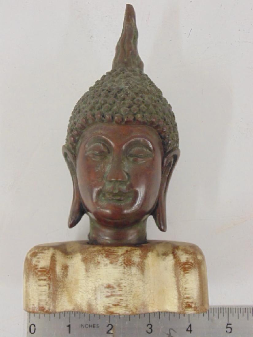 Bronze Buddha head, on wood base