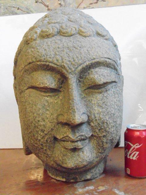 "Carved stone head of Buddha, 17"" tall"