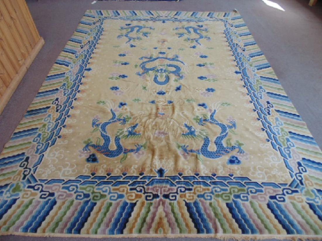 Chinese carpet, ivory field with blue striped border