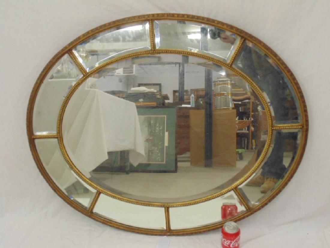 Oval beveled glass gilt framed mirror