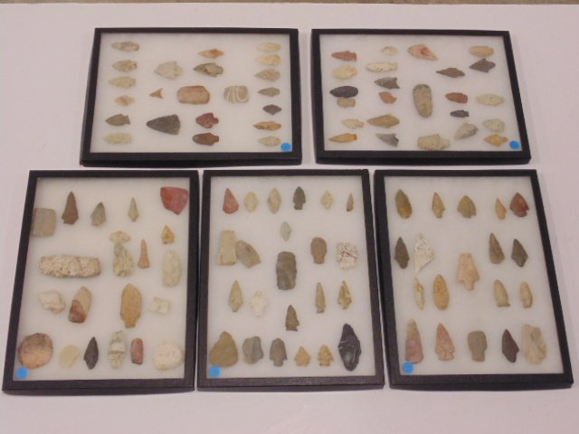 Collection of native Indian arrow heads, 5 riker mounts