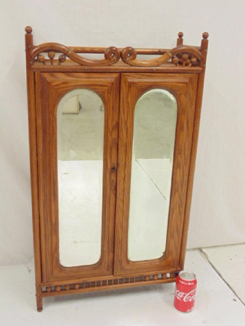 Oak stick & ball double door cabinet