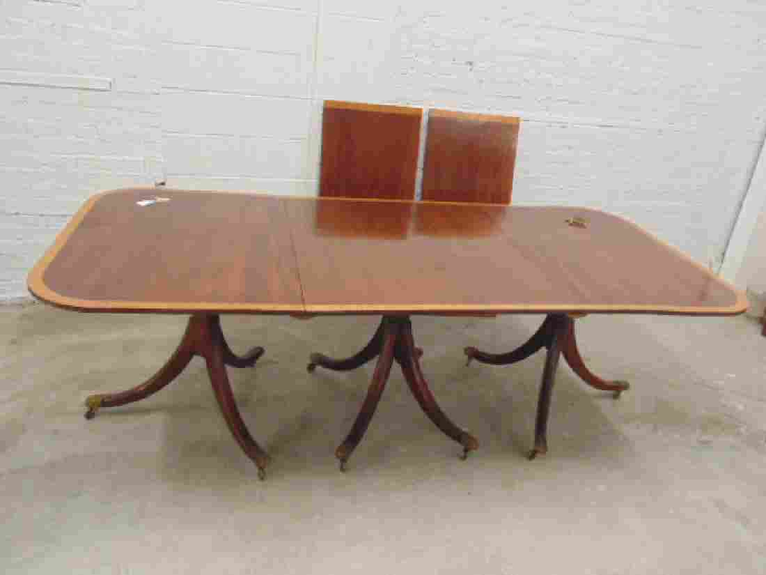 Triple pedestal inlaid mahogany dining table, with 2