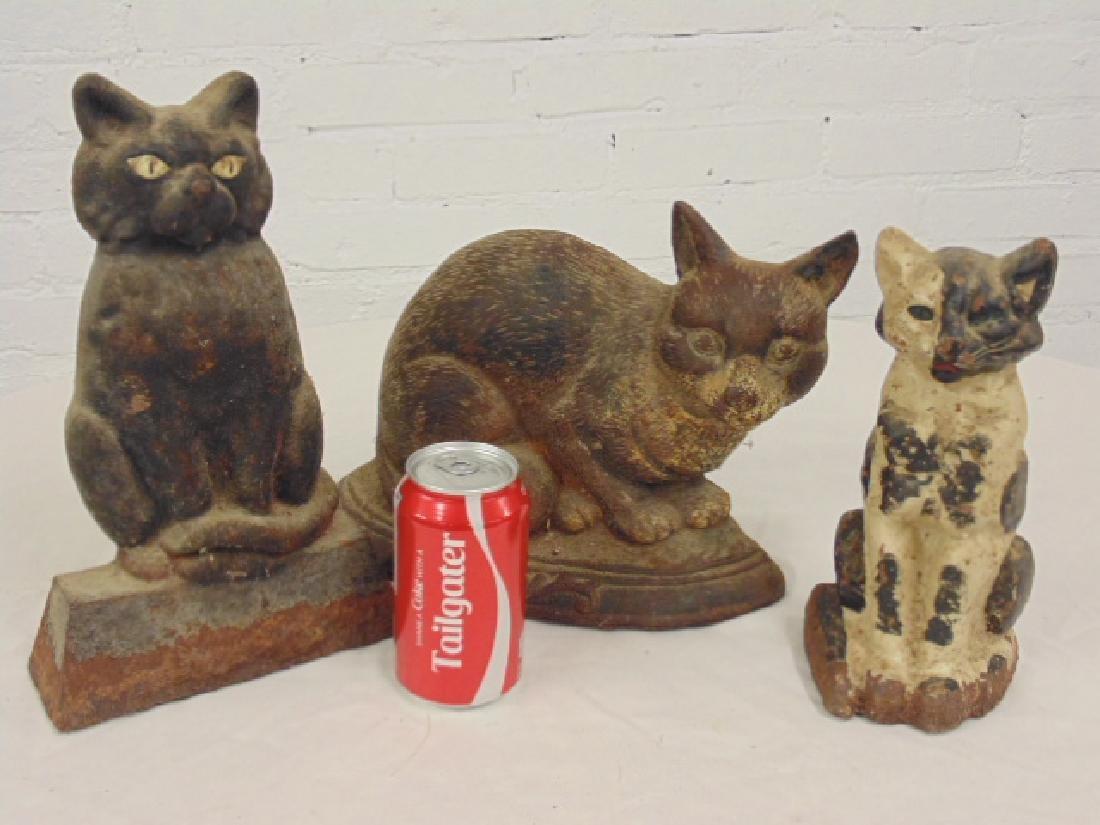 3 cast iron cat doorstops, original paint