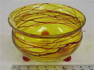 Art glass bowl yellow with red swirl decoration on 3