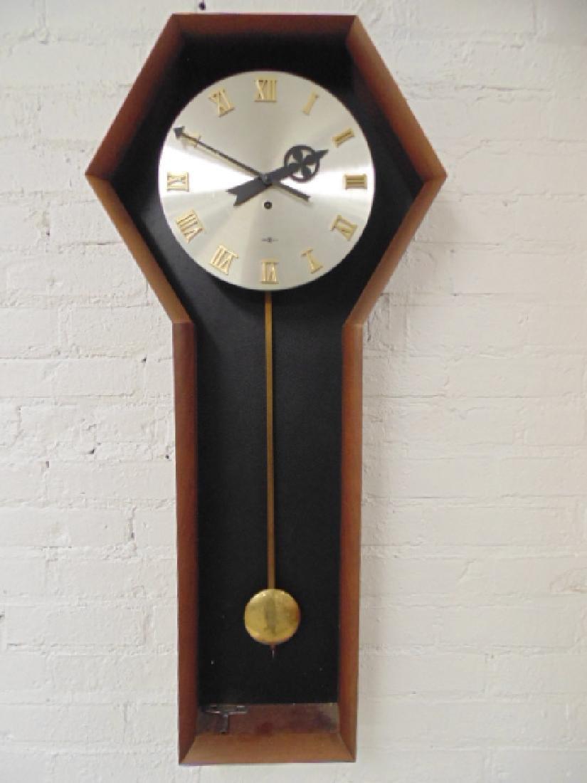 Howard Miller mid Century wall clock, model 557,