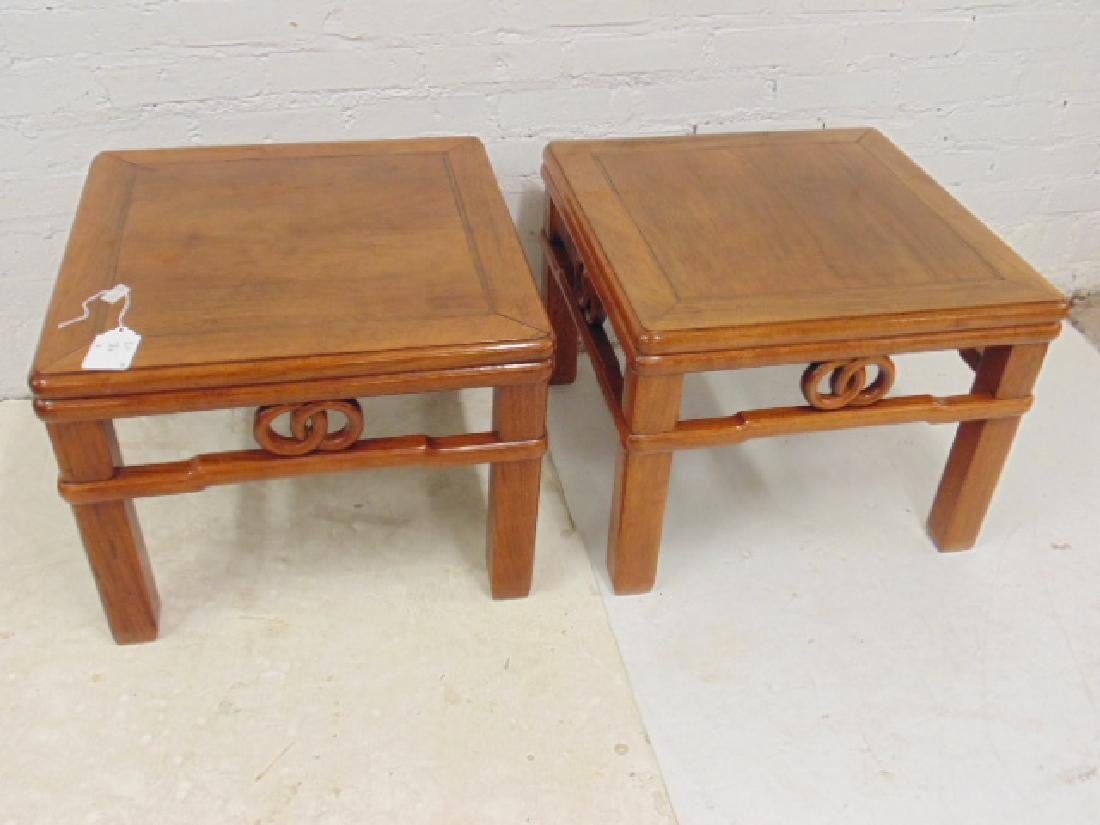 Pair Chinese side tables with carved skirts, each table