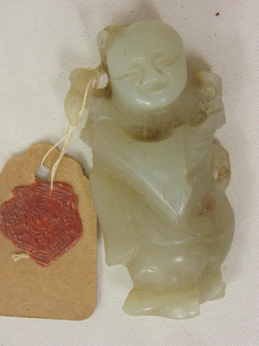 "Small Chinese carved Jade figure, 2"", with old tag with"