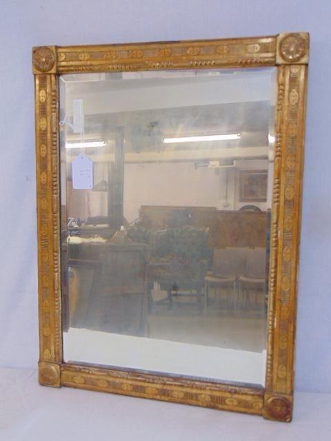 Beveled glass mirror in gilt frame, carved frame,