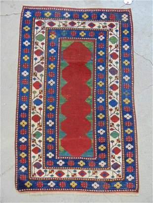Caucasian scatter rug, red center, blue / white border,