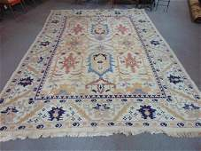 Caucasian style flat weave rug light colored field