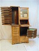 Carved oak dental cabinet, raised panel construction,