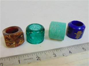 4 Chinese archer rings, glass, stone, ceramic, includes