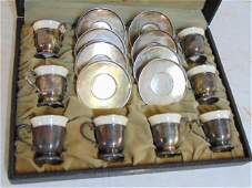 Lenox box set with sterling cups  saucers with Lenox