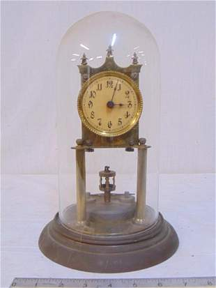 """400 day clock, with dome and pendulum, Signed """"D.R.G.M."""
