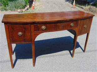 Mahogany sideboard, center drawer flanked by two doors,