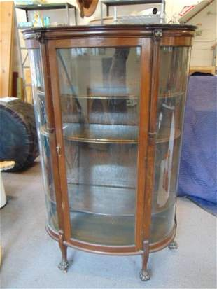 Curved oak china cabinet with wood shelves, claw feet,