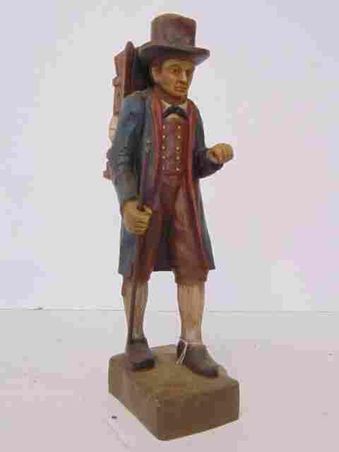 Traveling clock salesman statue
