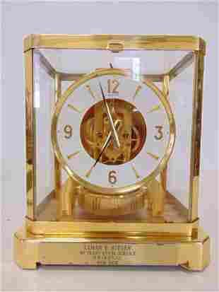 "Atmos Clock, SN 463663, C.1976, Placard reads "" Lyman E"