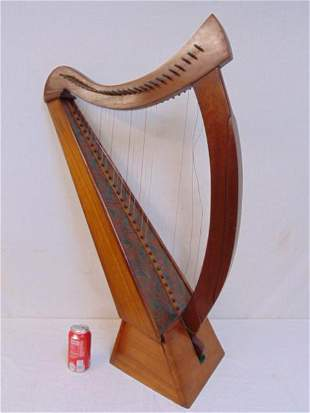 Paint decorated Irish harp, diminutive size, on stand,