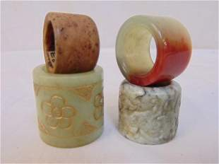 4 Chinese archer rings, carved jade, stone, one wood,