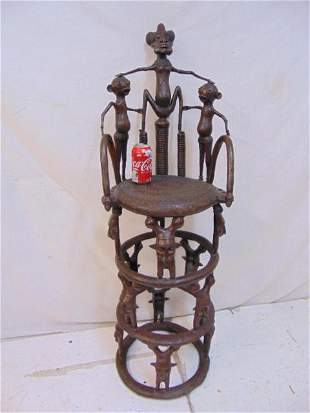 Bronze African chair decorated with various figures, ,
