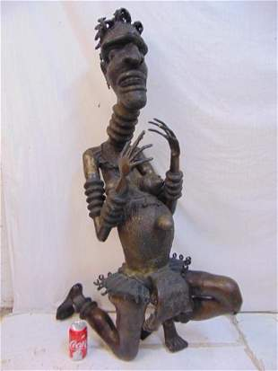Large African bronze figure, life size kneeling figure