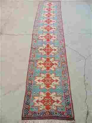"Runner, carpet, in red, blue, rug is 9'1"" by 23.5"""
