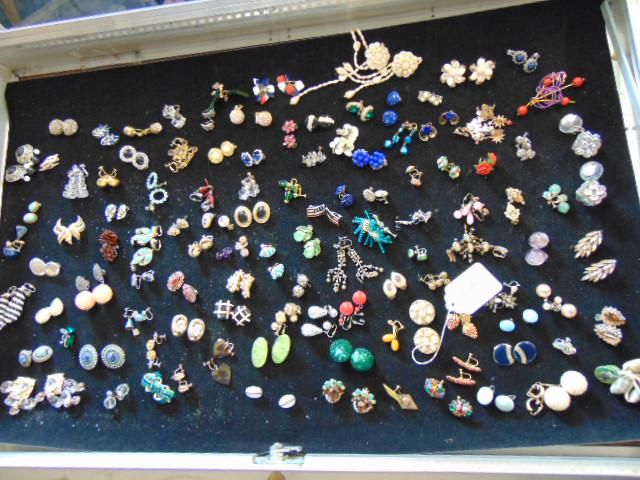 Large lot of costume jewelry earrings, showcase filled,