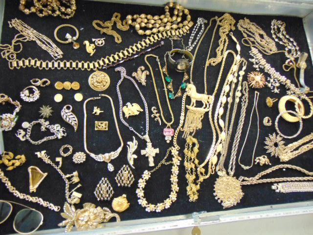 Large lot of gold toned costume jewelry, includes