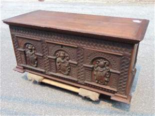 Jacobean carved chest, with carved armorial figures,