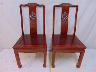 Pair Chinese side chairs, carved backs, with cushions,