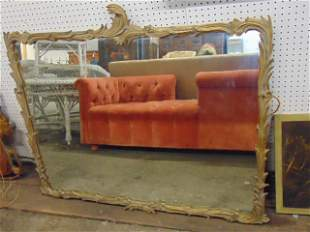 """Large gilt mirror in carved frame, mirror is 43.25"""" by"""
