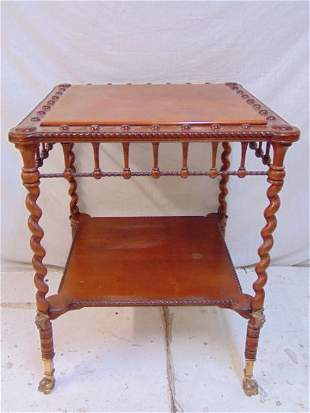 Mahogany side table with spiral legs, brass claw feet,
