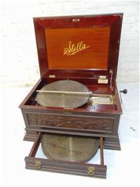 Stella Swiss made antique disk player, in mahogany
