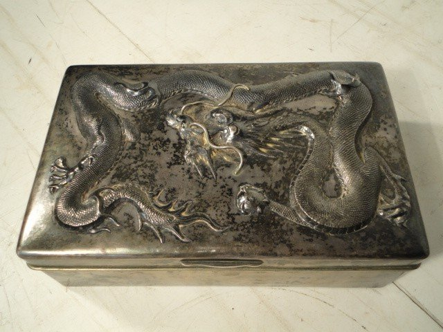 3: Silver box decorated with dragon.