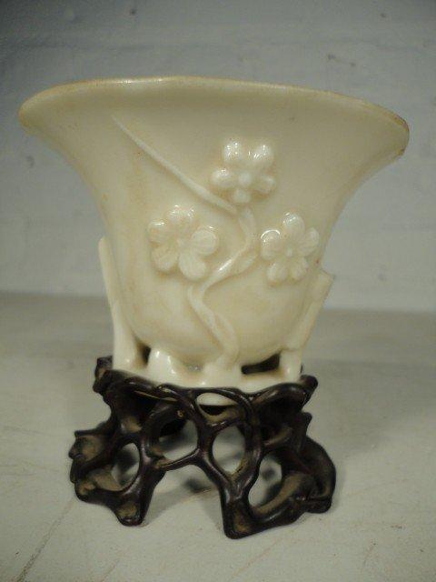 17: Small bowl on wood base
