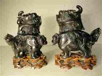 302: Pair carved green jade Foo dogs on basis