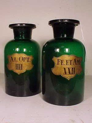 111: 2 green glass apothecary jars w/stoppers