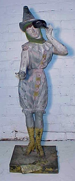 104: French paint decorated spelter figure with mask