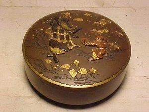 110: Japanese bronze round box with relief design.