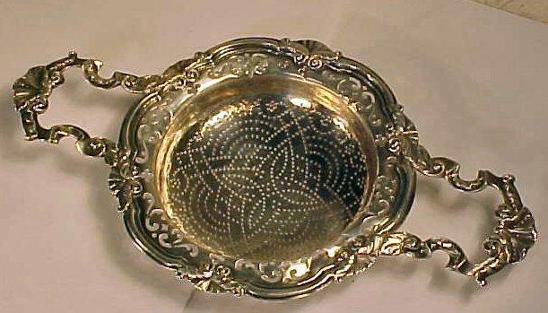 160: Silver lemon strainer, by Edward Aldridge, 1755