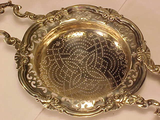 160: Silver lemon strainer, by Edward Aldridge, 1755 - 2