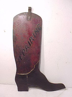 "111: Metal boot shaped sign, ""repairing"""