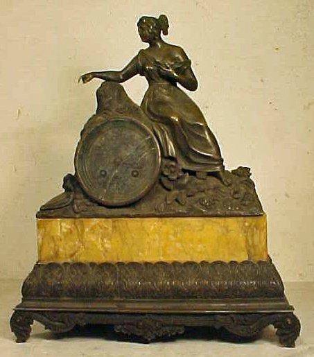 Empire bronze figural mantle clock, marble base